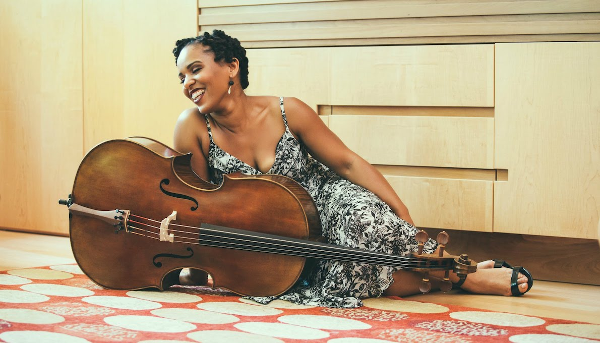 Shana Tucker lounges with her cello. Photo by Chris Charles for Creative Silence